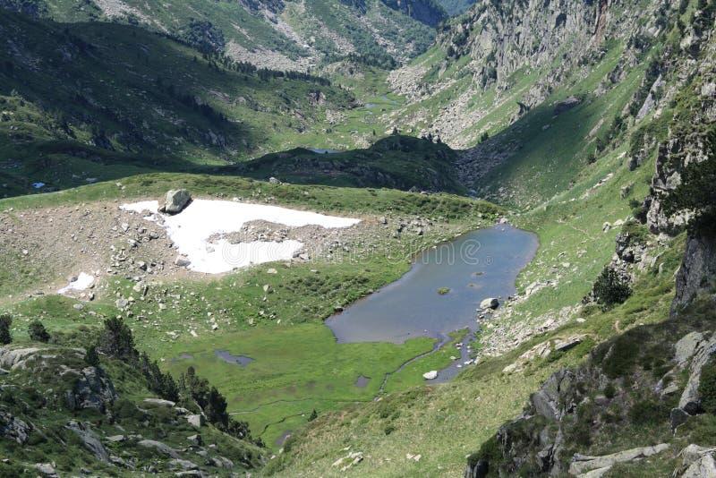Pyrenean lake in Ariege, France. Pyrenean lake in Ariege, Occitanie in south of the France. lake in Donezan stock images