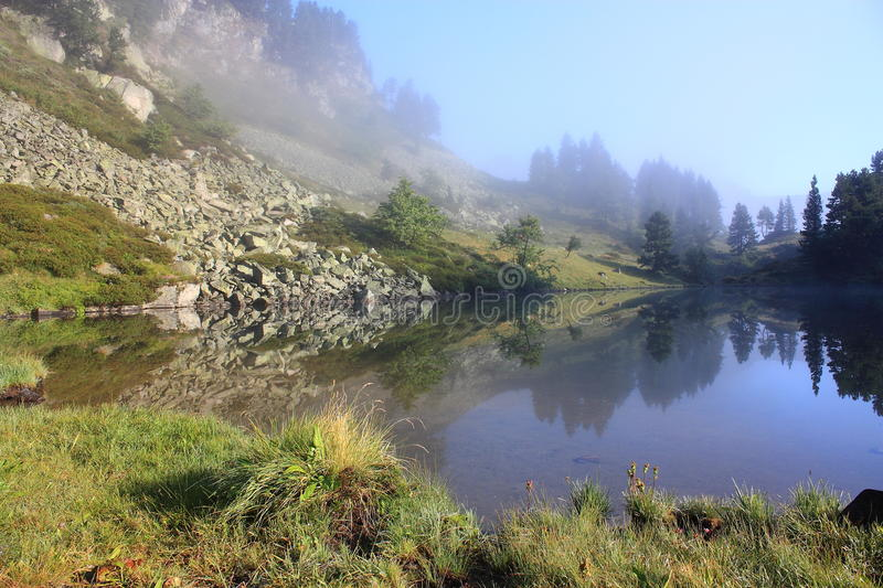 Pyrenean lake in Ariege, France. Pyrenean lake in Ariege, Occitanie in south of the France. Estagnet lake in Donezan royalty free stock photo