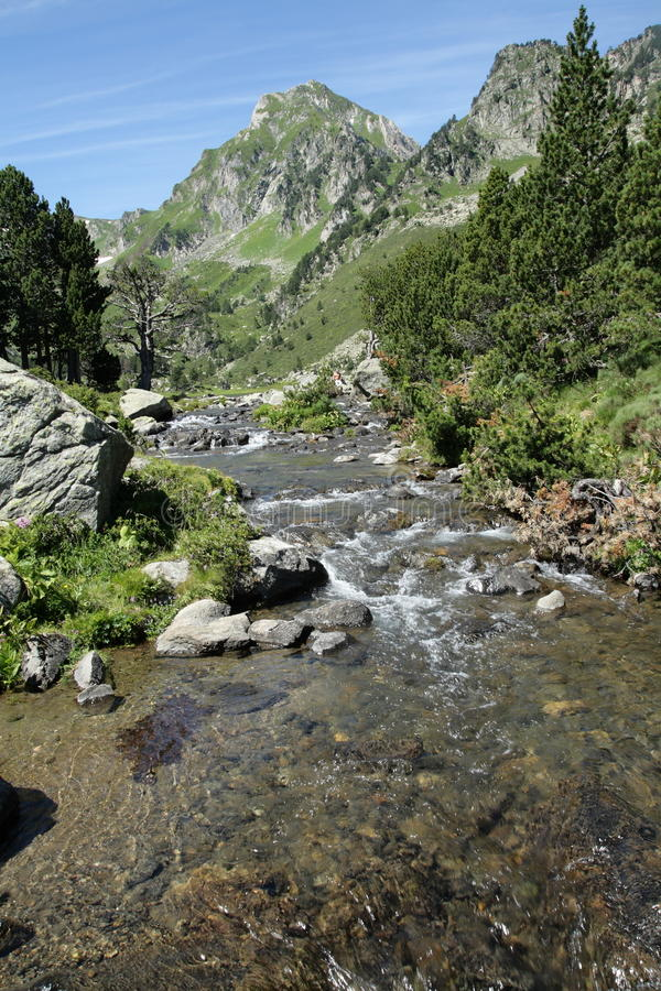 Pyrenean river in Ariege, France. Pyrenean river and Roc Blanc peak in Ariege, Occitanie in south of France royalty free stock photo