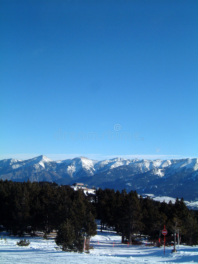 Pyrenees and chairlift. One of the Chairlifts at Font Romeu with the Pyrenees in the background stock photo