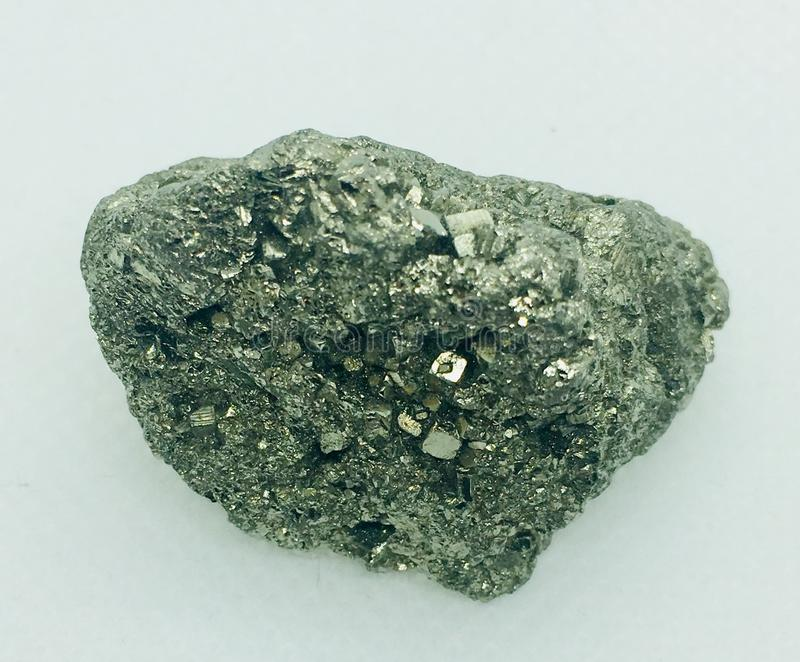 Pyrite crystal. Gold pyrite crystal isolate on white background stock image