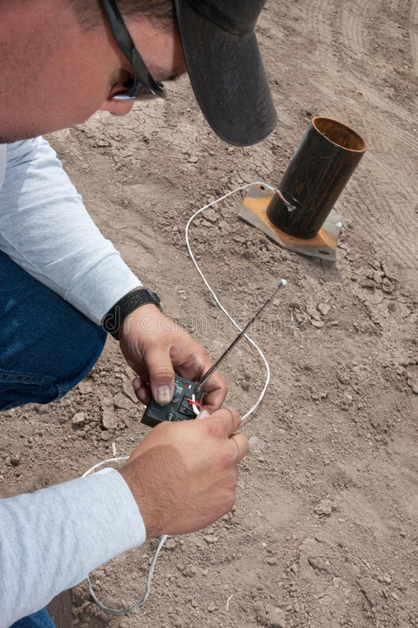 Pyrotechnic Expert Wiring a Remote Control. Pyrotechnic expert setting up remote control device stock photo