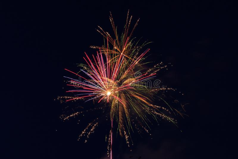 pyrotechnic show. fireworks in the night sky over the city. stock image