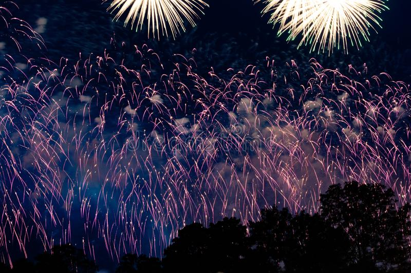 Pyrotechnic show in honor of the holiday. Scarlet Sails. The Great Pyrotechnic Show. A stunning fire festival. Celebration. Multicolored sky. Beautiful salutes stock photography