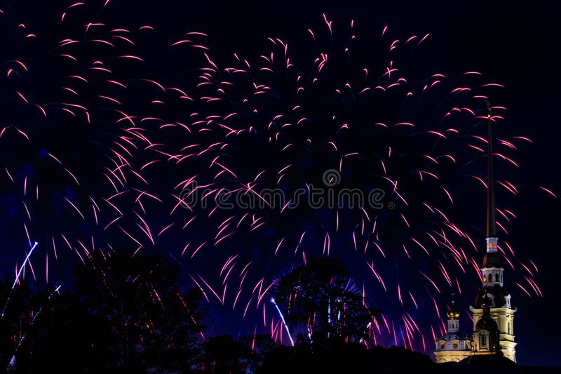 Pyrotechnic show in honor of the holiday in St. Petersburg, Russia. Scarlet Sails. Peter-Pavel`s Fortress. The Great Pyrotechnic Show. A stunning fire festival stock photography