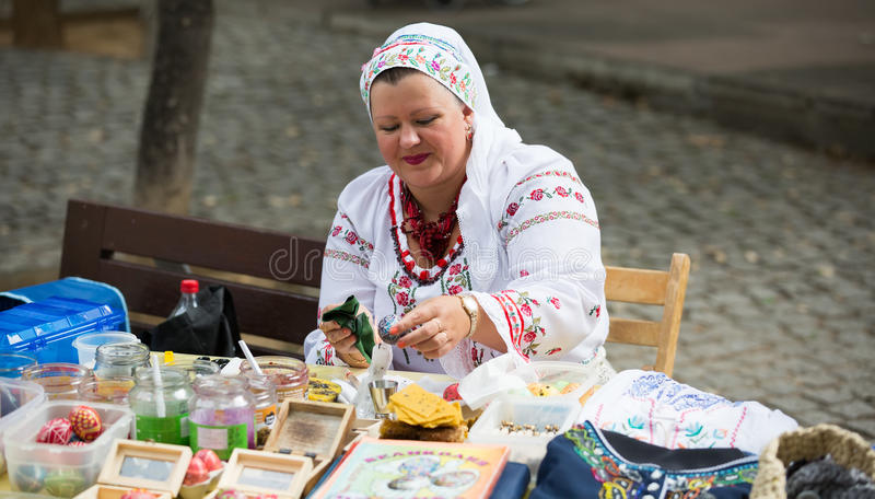 Pysanka sale at the Day of Ukrainian culture in Barcelona. BARCELONA, SPAIN - SEPTEMBER 06, 2015: Pysanky (Easter eggs) and other souvenirs for sale on display royalty free stock photos