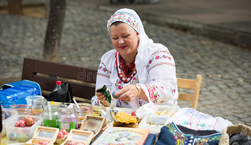 Pysanka sale at the Day of Ukrainian culture in Barcelona. BARCELONA, SPAIN - SEPTEMBER 06, 2015: Pysanky (Easter eggs) and other souvenirs for sale on display stock photo
