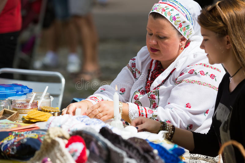 Pysanka sale at the Day of Ukrainian culture in Barcelona. BARCELONA, SPAIN - SEPTEMBER 06, 2015: Pysanky (Easter eggs) and other souvenirs for sale on display royalty free stock images