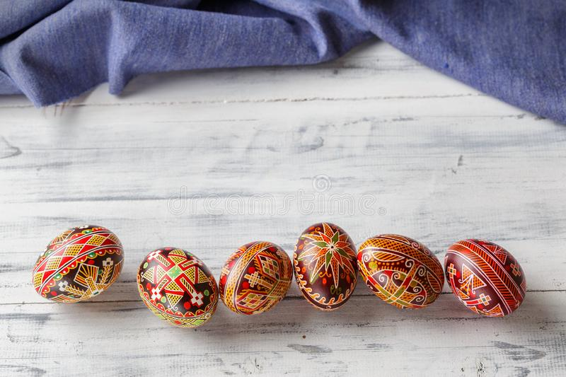 Easter eggs decorated with wax resist technique. Pysanky, Ukrainian Easter eggs decorated with wax-resist dyeing technique, traditional for Eastern European royalty free stock image