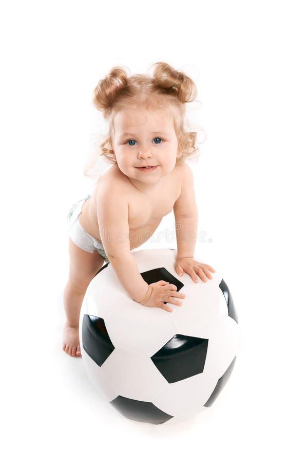Pyslekar med en fotbollboll royaltyfri foto