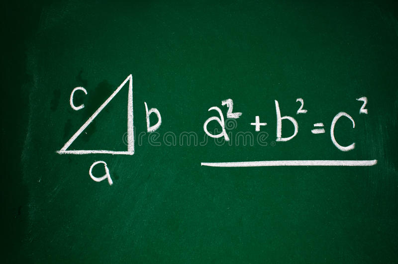 Pythagorean theorem. Sketched with white chalk on a chalk board stock photos