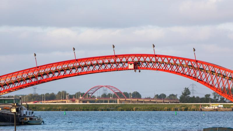 Python Bridge Arch. Red Python Bridge Arch in Amsterdam Netherlands stock photo
