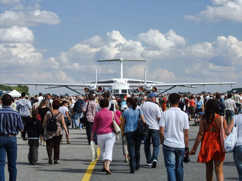 PZL M28 Skytruck and IL-76MD behind the visitors of Radom Air show. stock photography