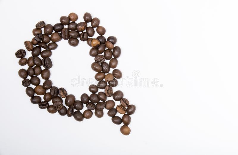 Q - large letter of english alphabet. Made up of unmolished roasted coffee beans on a white background stock images