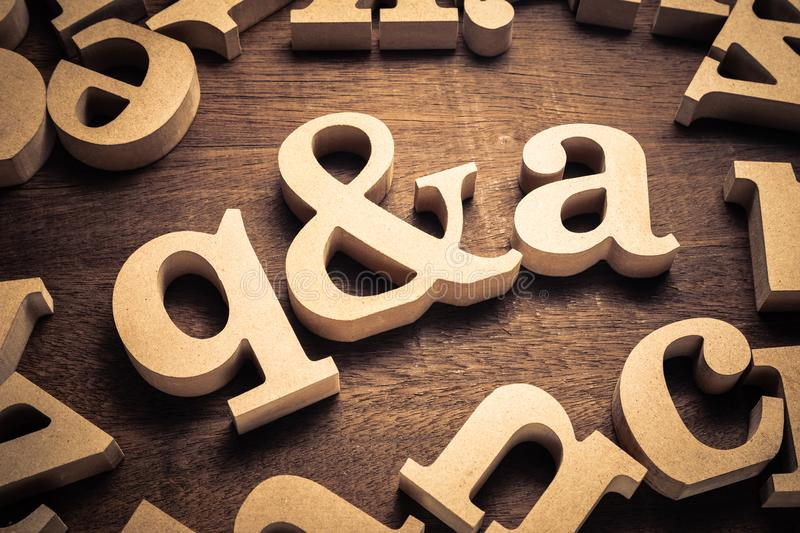 Q&A Wood Letters. Question and Answer, q and a by wood letters on wood background stock photo
