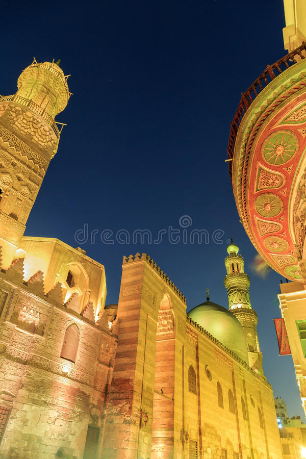 Qalawun complex,El Moez street at night. Its one of the most amazing streets in Islamic Cairo. El-Moez Street is one of the oldest streets in Cairo royalty free stock images