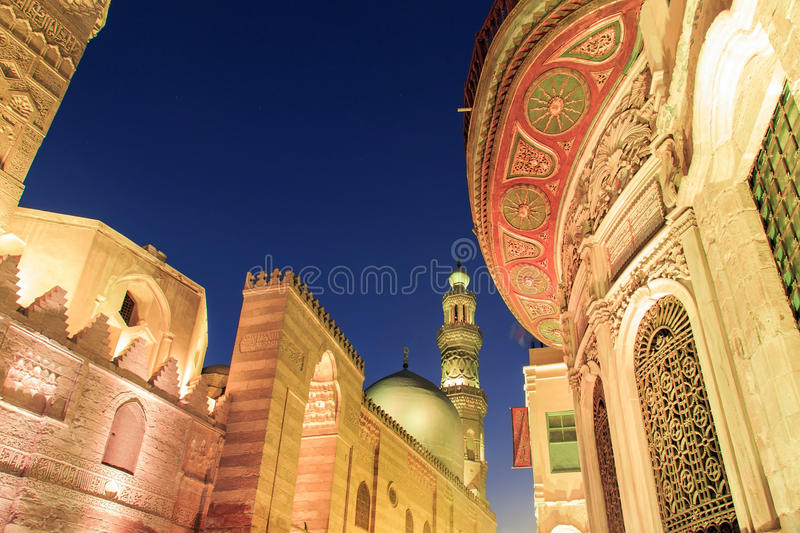 Qalawun complex,El Moez street at night. Its one of the most amazing streets in Islamic Cairo. El-Moez Street is one of the oldest streets in Cairo royalty free stock photo