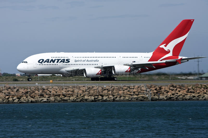 Qantas Airbus A380 on runway. 4 November 2010: A midair explosion in an engine of a Qantas A380 airliner forces an emergency landing in Singapore, and grounding