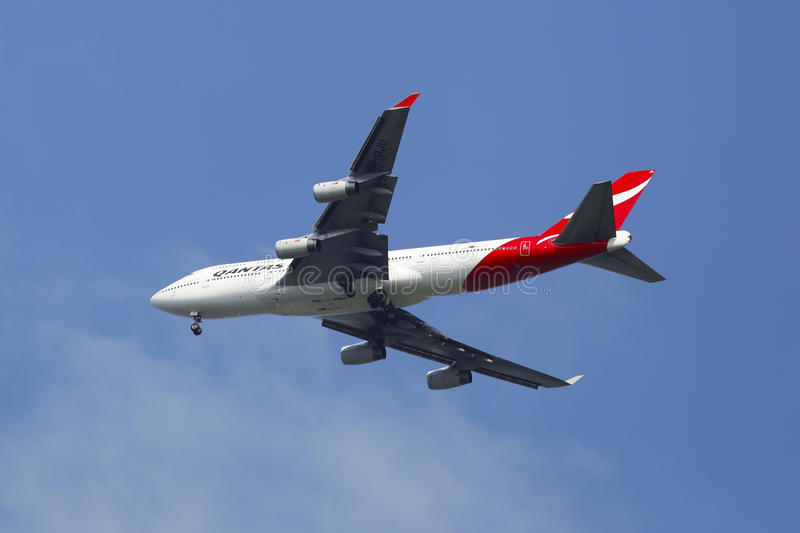 Qantas Airline Boeing 747-400 in New York sky befo. NEW YORK - JULY 20 Qantas Airline Boeing 747-400 in New York sky before landing at JFK Airport on July 20 stock photography