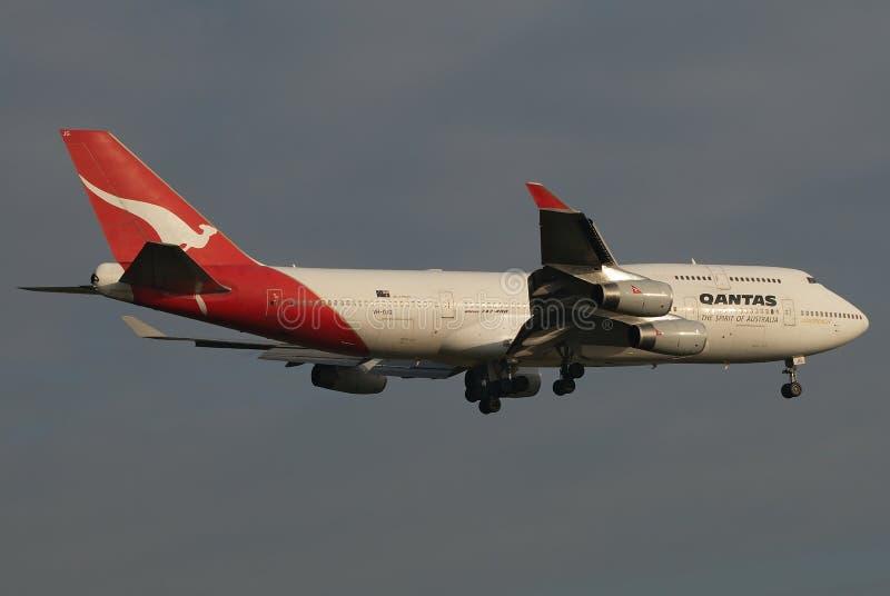 Qantas Jumbo Plane. Qantas Boeing 747, aka Jumbo, about to land after a long flight to Europe stock photos