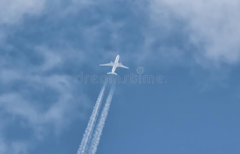 Qatar airlines plane flies in the sky at an altitude of 10 km above sea level stock image