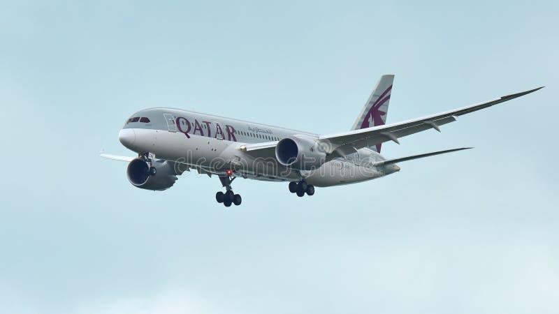 Qatar Airways Boeing 787 Dreamliner landing at Changi Airport stock photo