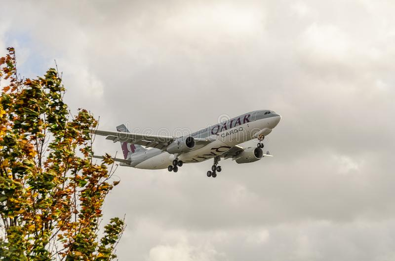 Qatar Airways  freight jet landing at Heathrow. Quatar Airways jet landing at Heathrow, october 2017 landing Gear down, airbus stock image