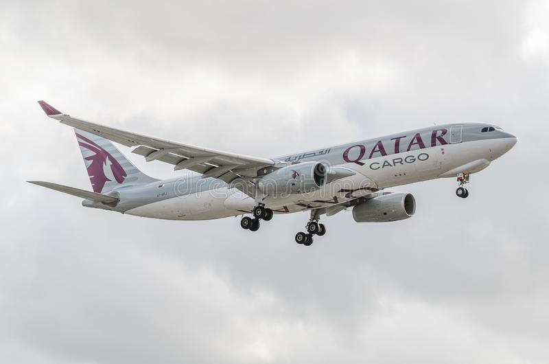 Qatar Airways  freight jet landing at Heathrow. Quatar Airways jet landing at Heathrow, october 2017 landing Gear down, airbus stock photos