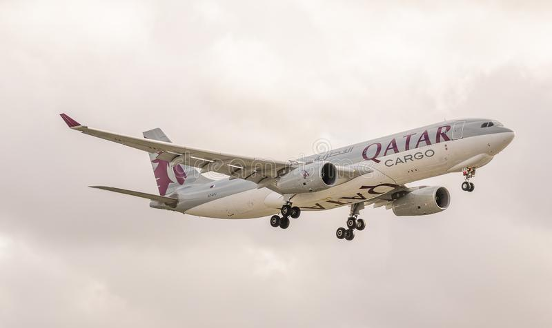 Qatar Airways  freight jet landing at Heathrow. Quatar Airways jet landing at Heathrow, october 2017 landing Gear down, airbus stock photography