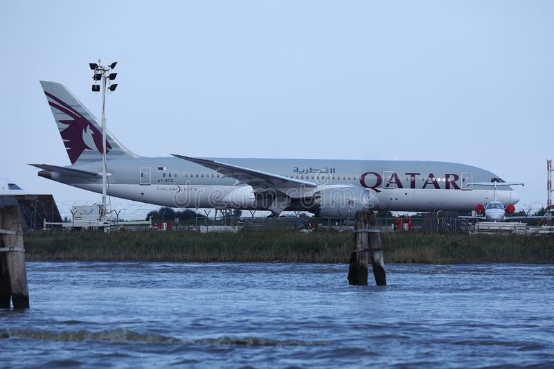 Qatar Airways Plane taxiing in Marco Polo Airport, Venice royalty free stock image