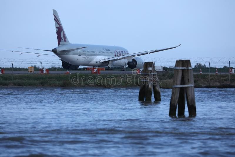 Qatar Airways Plane taxiing in Marco Polo Airport, Venice. VCE stock photography