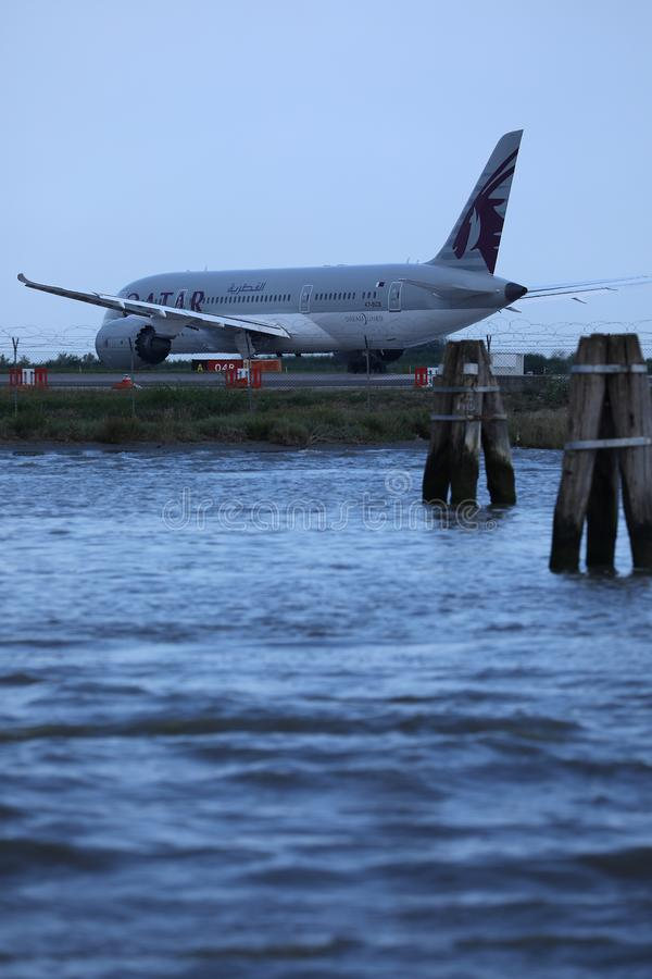 Qatar Airways Plane taxiing in Marco Polo Airport, Venice. VCE royalty free stock images