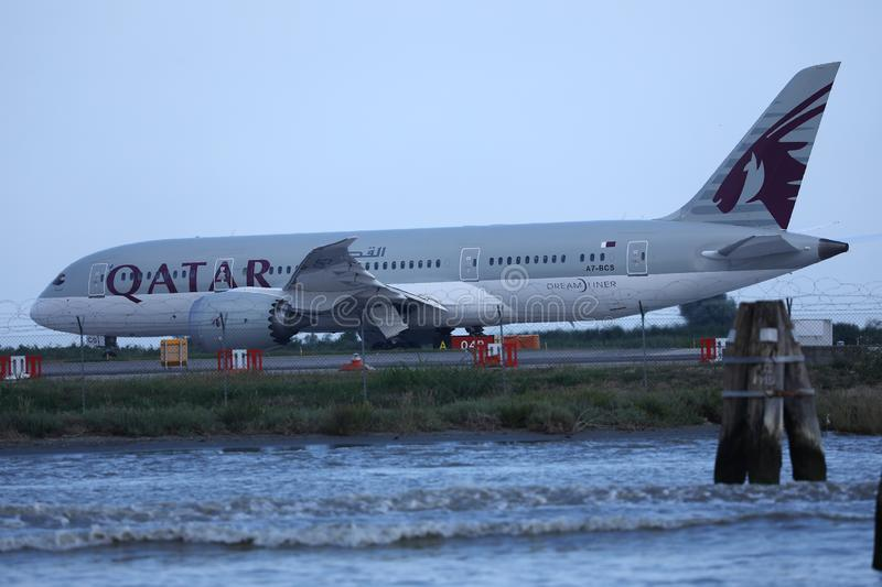 Qatar Airways Plane taxiing in Marco Polo Airport, Venice. VCE stock image