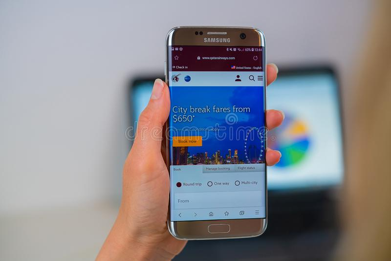 Qatar airways web site on mobile phone royalty free stock photography