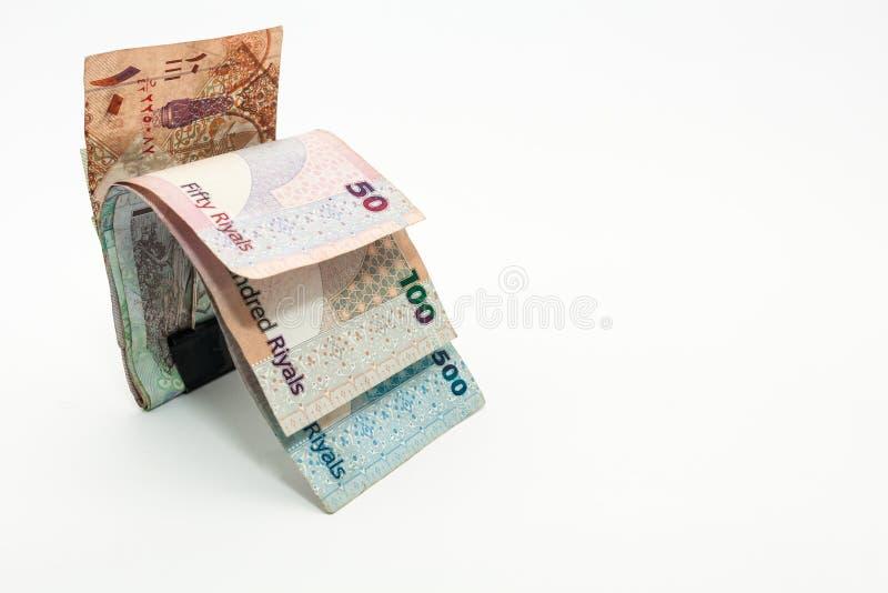 Qatar currencies Hundred Riyal, five hundred riyal, hundred riyal,fifty riyal, ten riyal, five riyal and one riyal. With black clip stock photography