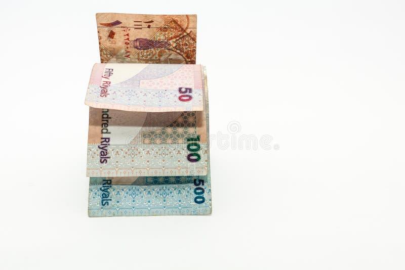 Qatar currencies Hundred Riyal, five hundred riyal, hundred riyal,fifty riyal, ten riyal, five riyal and one riyal. With black clip royalty free stock photography