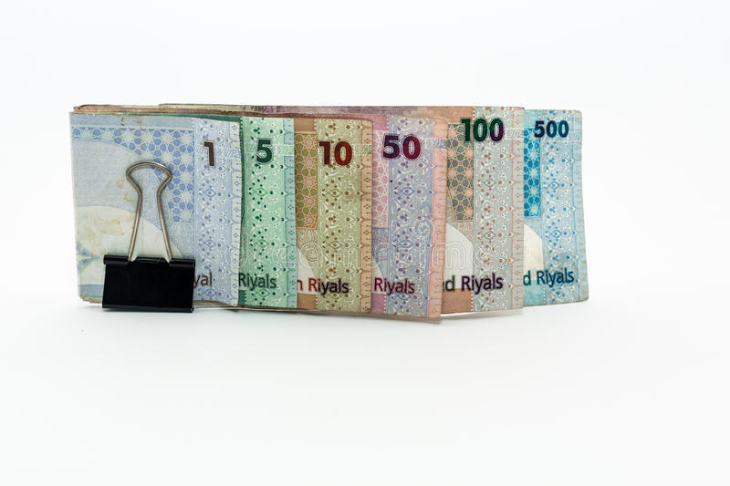 Qatar currencies Hundred Riyal, five hundred riyal, hundred riyal,fifty riyal, ten riyal, five riyal and one riyal. With black clip stock images