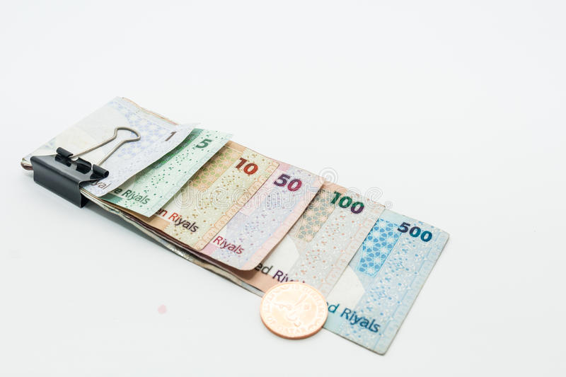 Qatar currencies Hundred Riyal, five hundred riyal, hundred riyal,fifty riyal, ten riyal, five riyal and one riyal. And coins with black clip royalty free stock photos