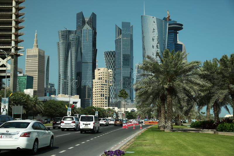 Road traffic in financial centre in Doha, Qatar stock images
