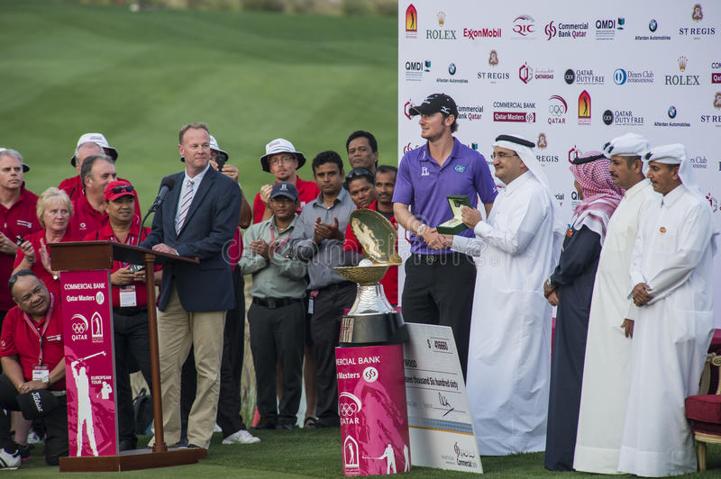 Qatar Masters 2013. DOHA, QATAR - JANUARY 26: Chris Wood receiving a Rolex watch after winning the US$2.5 million Commercial Bank Qatar Masters in style with an royalty free stock image