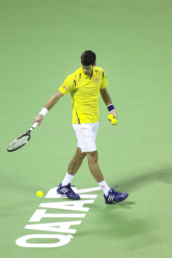 Qatar Total Open 2016. QATAR-JANUARY 4: Serbian tennis player Novak Djokovic plays his first match in 2016. on January 4, 2016 in Doha, Qatar royalty free stock photos