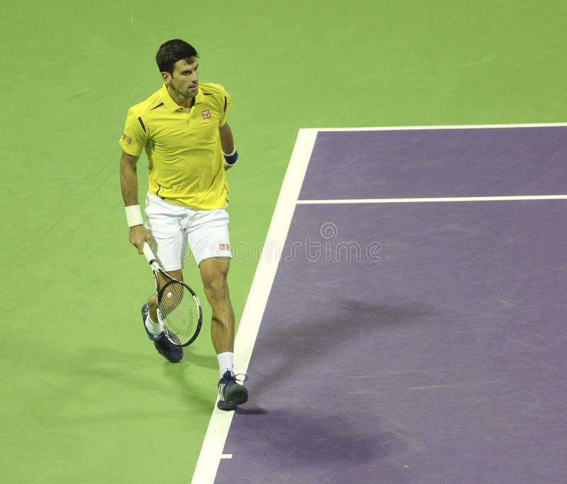 Qatar Total Open 2016. Serbian tennis player Novak Djokovic plays his first match in 2016. on January 4, 2016 in Doha, Qatar stock photo