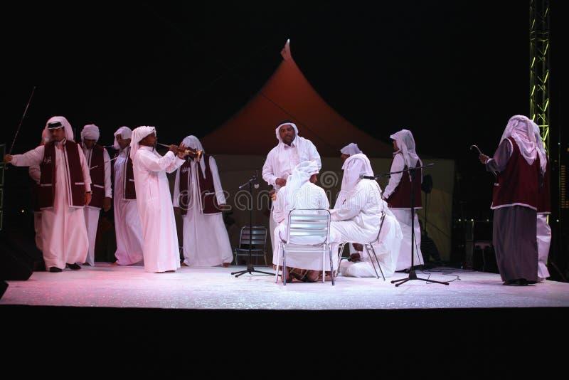 Qatari cultural troupe perform stock images