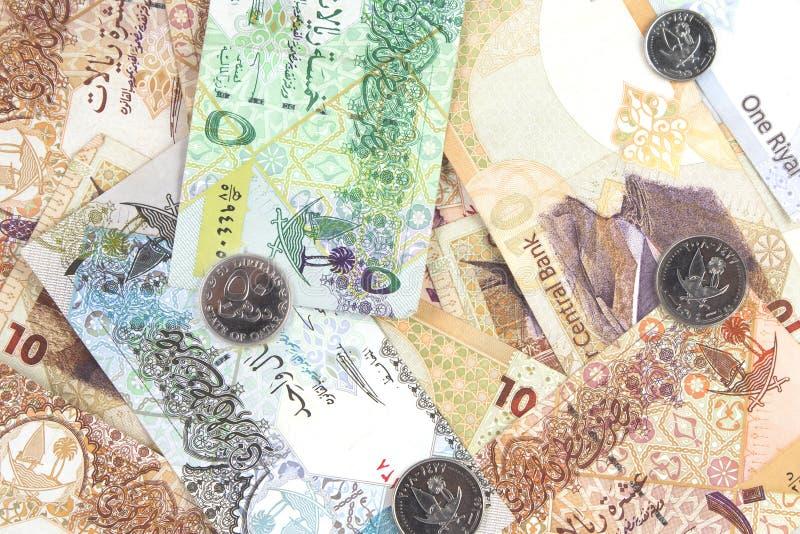 Qatari-RiyalsDevisenwechsel und Münzen als Hintergrund stockbilder