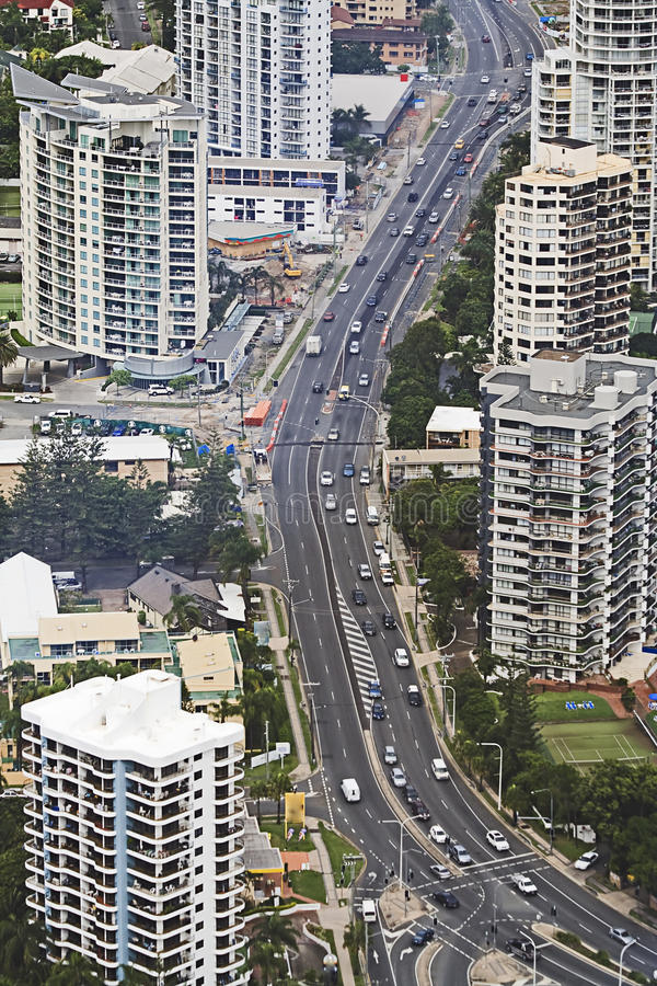 QE GC Cityroad aerial. Main transportation road of gold coast city Surfers paradise as seen from above. Tall hotels and skyscrapers around the street with heavy royalty free stock image