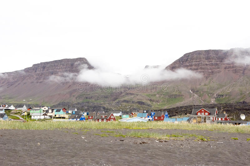 Qeqertarsuaq, Greenland. Table mountains coming out the fog in Qeqertarsuaq, Greenland royalty free stock images
