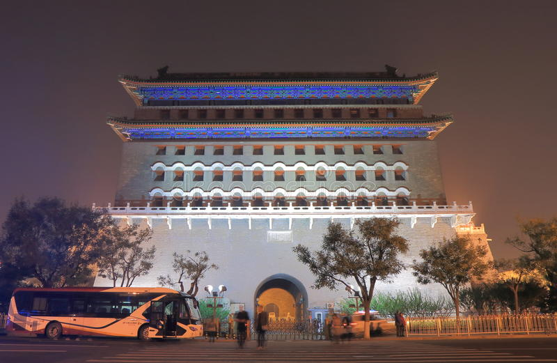 Qianmen street cityscape Beijing China. People visit historical Qianmen gate in Beijing China. Qianmen was built in 1419 and the colloquial name for Zhengyangmen stock photo