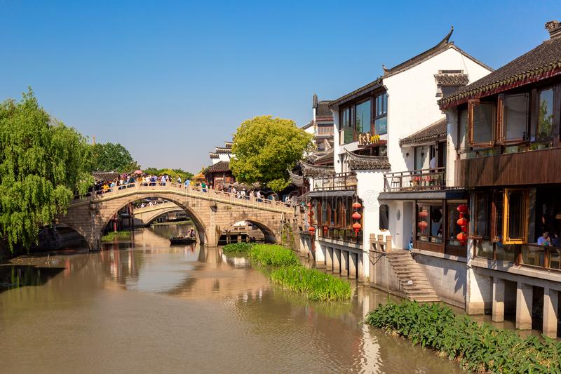Qibao Shanghai, China - May, 2019: Landscape of Qibao Old Town in Shanghai, China. Brick bridge over the river in Qibao.  stock photography