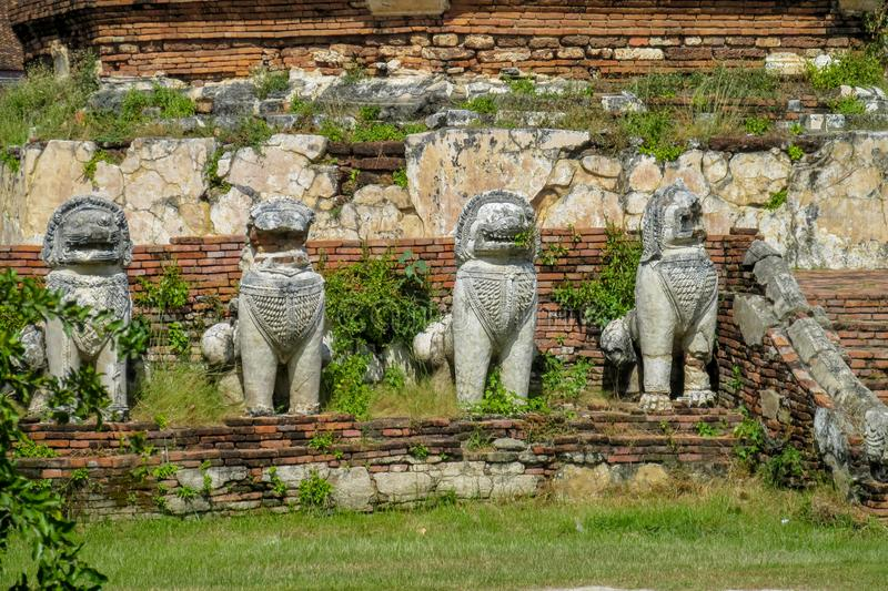 Qilin asian mythological guard statue in ancient Thai temple royalty free stock photos