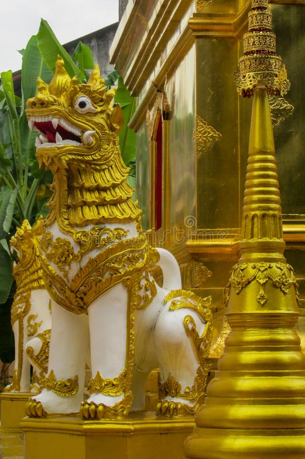 Qilin asian mythological guard statue in Thai temple stock photography